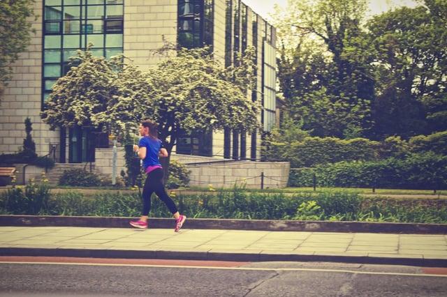 Woman jogging on a city sidewalk