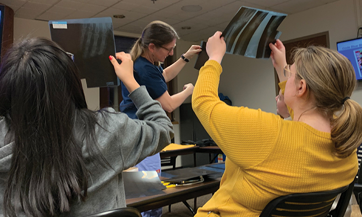 healthcare-CTE-students-looking-at-x-rays-in-classroom
