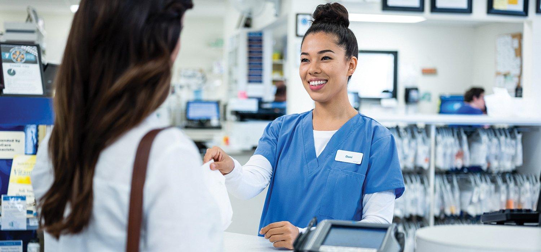 pharmacy-tehcnician-helping-customer-at-retail-counter-header-image